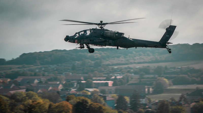 """A U.S. Army AH-64 Apache attack helicopter from the 12th Combat Aviation Brigade flies over the town of Belfort, France, in a """"show of force"""" fly-by during distinguished visitors' demonstration day for NATO Exercise Royal Blackhawk 20. Photo Credit: Maj. Robert Fellingham, Army"""