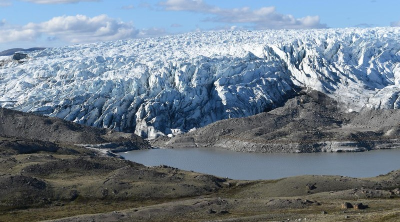 A newly forming lake at the edge of the Greenland ice sheet, exposing sediments released by the ice. Such lake beds are becoming common as the ice recedes. CREDIT: Kevin Krajick/Earth Institute