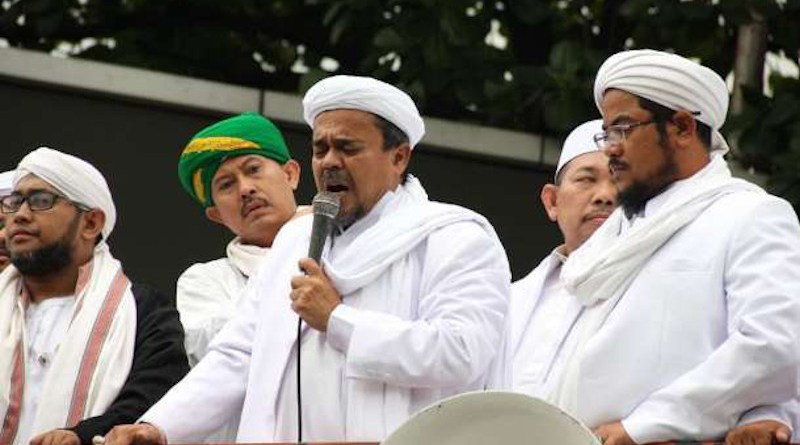 Muhammad Rizieq Syihab (with microphone) is seen at a protest in Jakarta in October 2106. Syihab returned to Indonesia on Nov. 10 after more than three years living in exile in Saudi Arabia. (Photo: Ryan Dagur/UCA News)