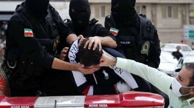 Iranian security forces detain a protestor. Photo Credit: Iran News Wire