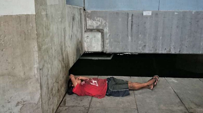 A homeless man sleeps under a bridge in Bangkok, Thailand. Photo: UCA News