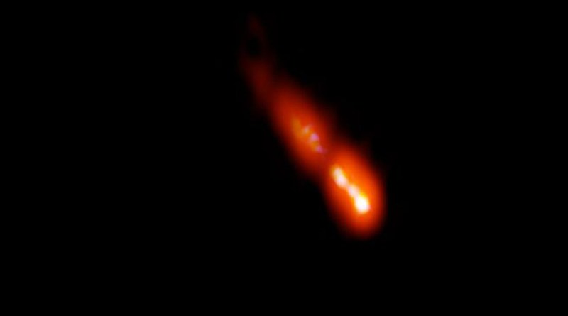 VLBA image of the blazar PSO J0309+27 at a distance of 12.8 billion light-years from Earth. Galaxy's core is at bottom right, and jet is propelled outward from the core toward upper left. CREDIT Spingola et al.; Bill Saxton, NRAO/AUI/NSF.