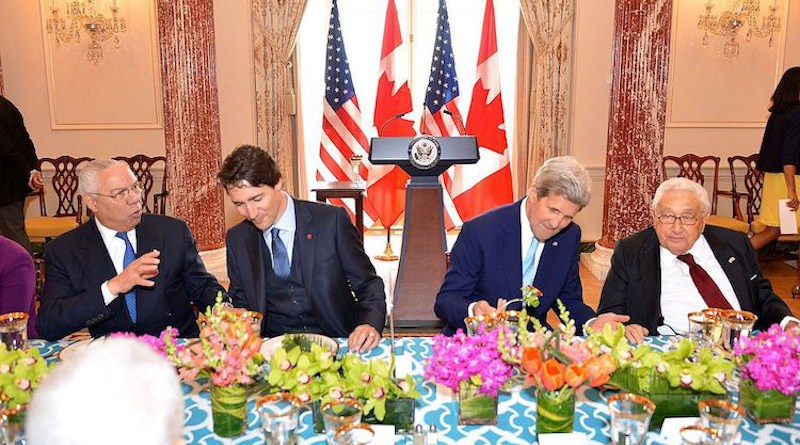 From left to right, former U.S. Secretary of State Colin Powell, Canadian Prime Minister Justin Trudeau, U.S. Secretary of State John Kerry, and former U.S. Secretary of State Henry Kissinger chat at the State Luncheon in honour of the Prime Minister at the U.S. Department of State in Washington, D.C., on March 10, 2016. [State Department photo/ Public Domain]
