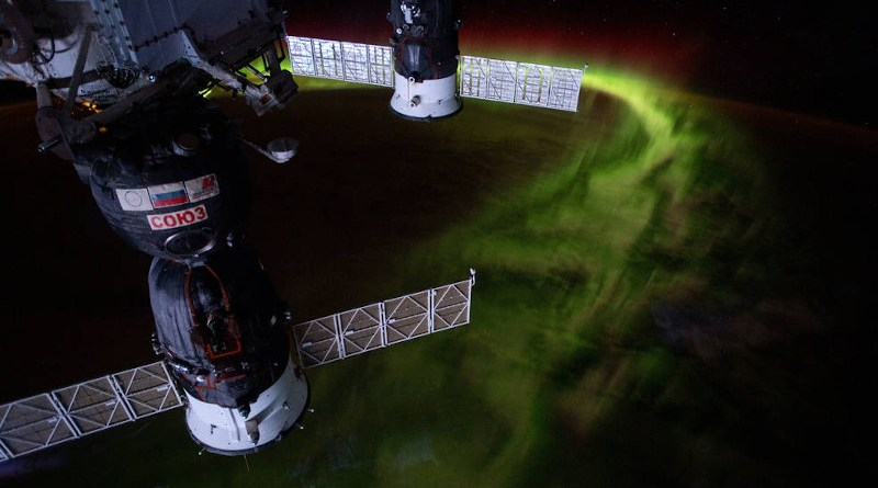 """From the International Space Station's orbit 269 miles above the Indian Ocean southwest of Australia, this nighttime photograph captures the aurora australis, or """"southern lights."""" Russia's Soyuz MS-12 crew ship is in the foreground and Progress 72 resupply ship in the background. Credits: NASA"""