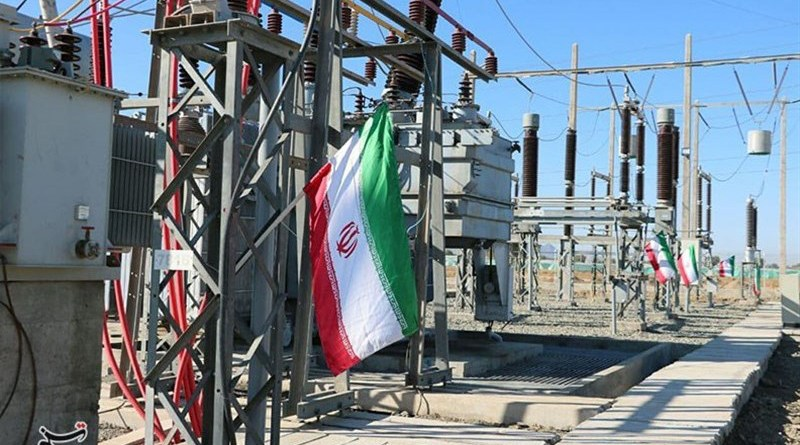 Iran flag and electricity power stations. Photo Credit: Tasnim News Agency