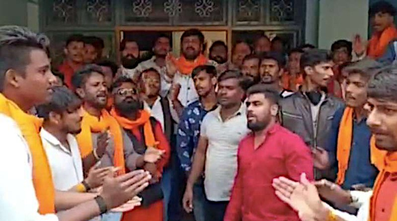 Right-wing Hindu activists shout slogans inside Satprakashan Sanchar Kendra in Indore city on Jan. 26 after accusing the Catholic media center of engaging in illegal religious conversion. (Photo: UCA News)