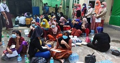 Rohingya Muslims sit on the ground during a police raid on two houses where they were staying while en route to Malaysia, in Shwepyitha township, Myanmar's Yangon region, Jan. 6, 2021. Photo courtesy of Yangon Region Police Force