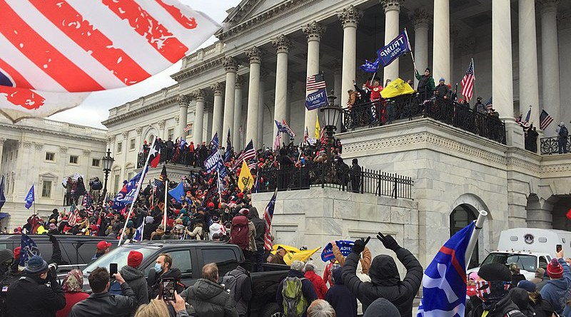 Trump supporters crowding the steps of the Capitol in Washington DC after displacing police shield wall preventing access. Photo Credit: TapTheForwardAssist, Wikipedia Commons