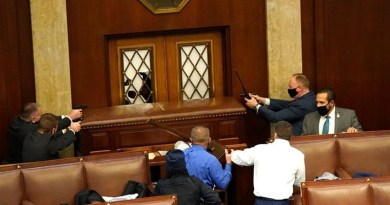 Security personnel protect doors from rioters entering the United States Capitol. Photo Credit: Tasnim News Agency