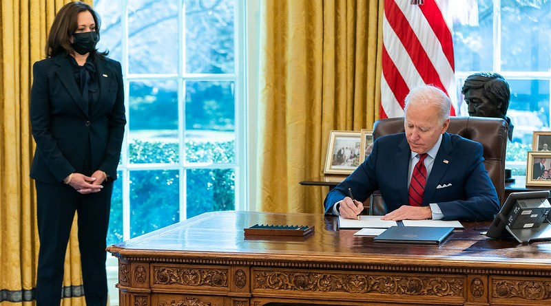 President Joe Biden, joined by Vice President Kamala Harris, signs executive orders. (Official White House Photo by Adam Schultz)