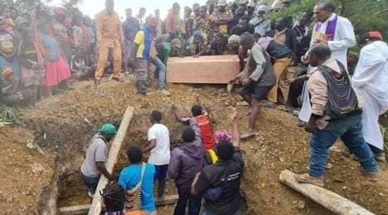 Janius Bagau, Soni Bagau and Justinus Bagau are buried in Bilogai village on Feb. 16. The three Papuans were beaten to death by Indonesian soldiers at a clinic where Janius was seeking medical aid. (Photo supplied)