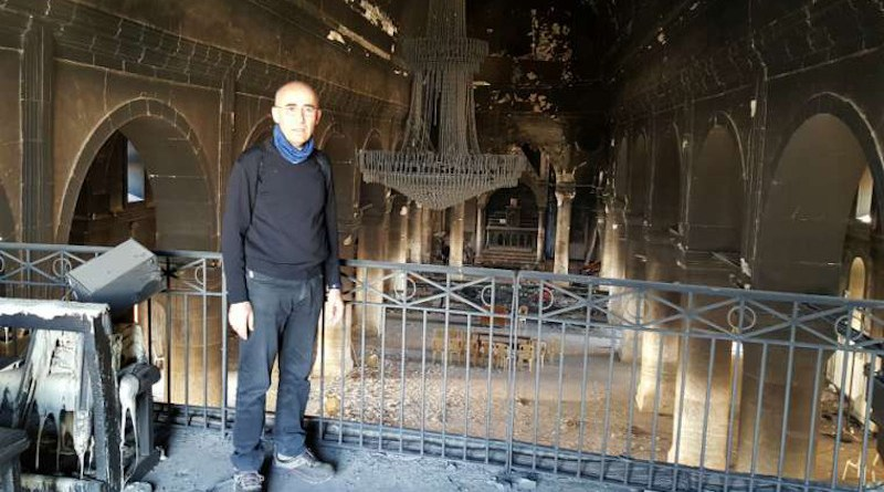 Fr. Georges Jahola in Al-Tahira church in Bakhdida in November 2016, shortly after the town's liberation. Photo courtesy of Fr. Jahola.