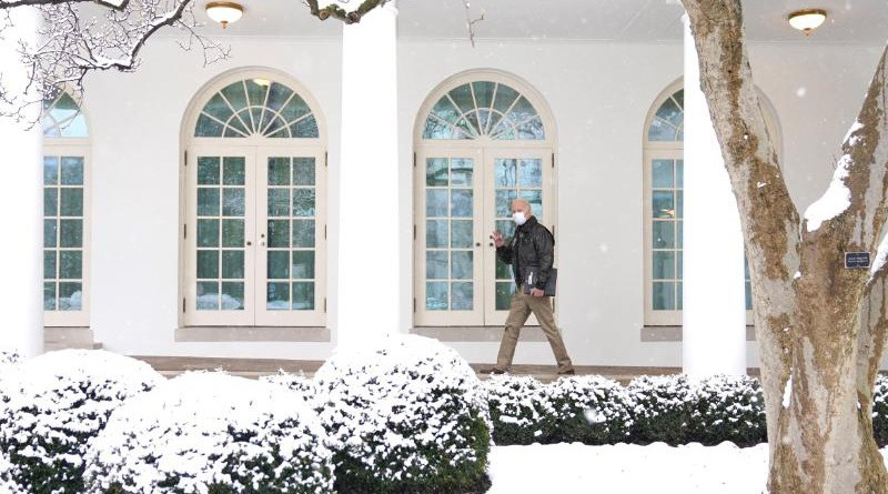 US President Joe Biden walks in the snow at the White House. Photo Credit: White House
