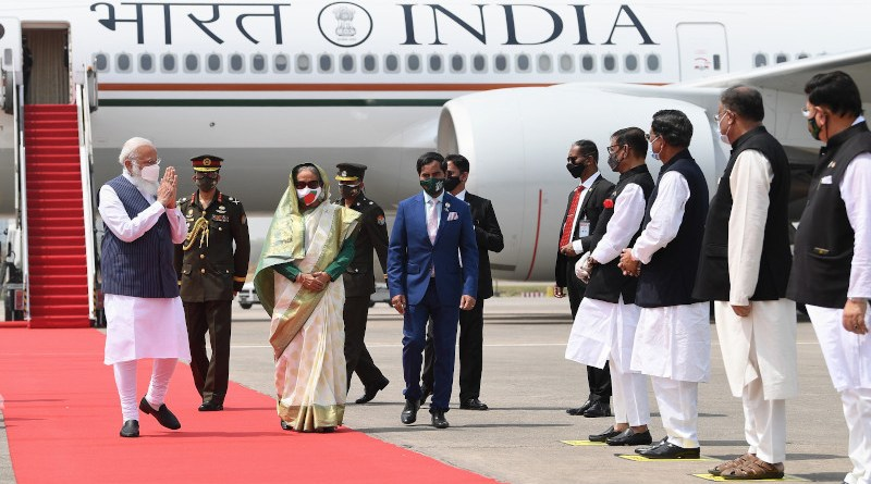 India's Prime Minister, Shri Narendra Modi being received by the Prime Minister of Bangladesh, Ms. Sheikh Hasina, on his arrival at Hazrat Shahjalal International Airport, in Dhaka, Bangladesh. Photo Credit: PM India