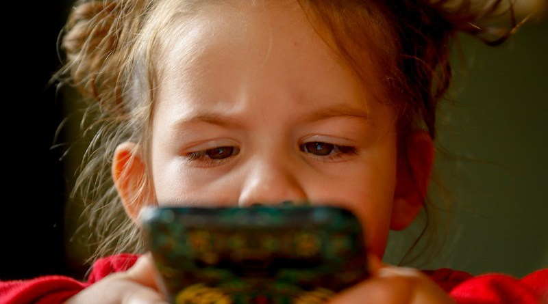 baby girl child smartphone technology videogame video game