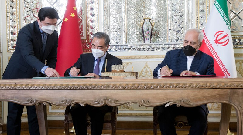 China's Foreign Minister Wang Yi and Iran's Foreign Minister Mohammad Javad Zarif sign strategic agreements. Photo Credit: Mehr News Agency