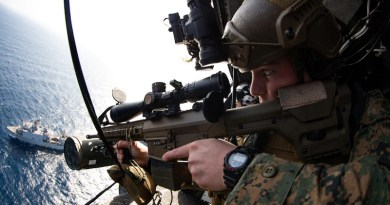 Reconnaissance Marine with Maritime Raid Force, 31st Marine Expeditionary Unit, provides aerial security using M110 semi-automatic sniper system during visit, board, search, and seizure mission after taking off from USS America, Philippine Sea, January 24, 2021 (U.S. Marine Corps/Brandon Salas)