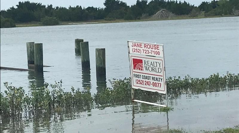 A real estate sign on flooded land in Carteret County, North Carolina. CREDIT Miyuki Hino