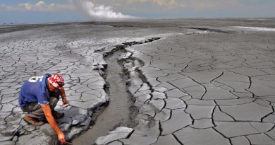 The Lusi eruption: A non accessible 650 m in diameter hot mud pond surrounds the central vents zone (rising plume is seen in the horizon). The erupted mud reaches temperatures of 100 °C and extensive oil slicks can be observed. Photo: Adriano Mazzini/CEED/UiO