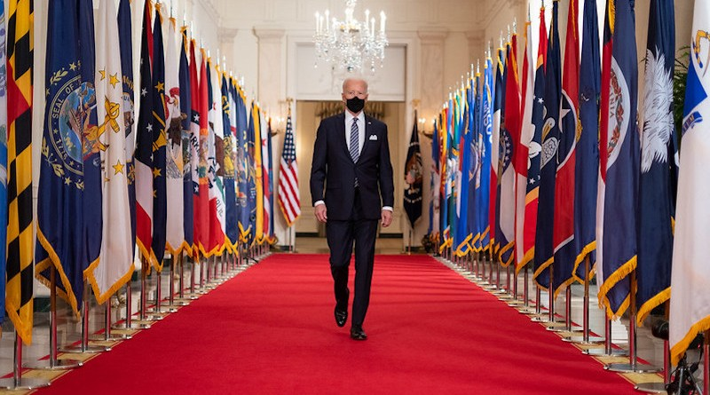 US President Joe Biden walks in the State Dining Room of the White House. (Official White House Photo by Adam Schultz)