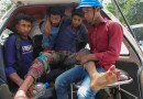 An injured man is loaded into a van after police fired on people protesting over wages and benefits at a Chinese-financed power plant in Banshkhali sub-district, southeastern Bangladesh, April 17, 2021. Photo Credit: BenarNews
