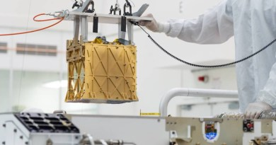 Technicians at NASA's Jet Propulsion Laboratory lower the Mars Oxygen In-Situ Resource Utilization Experiment (MOXIE) instrument into the belly of the Perseverance rover. Credits: NASA/JPL-Caltech