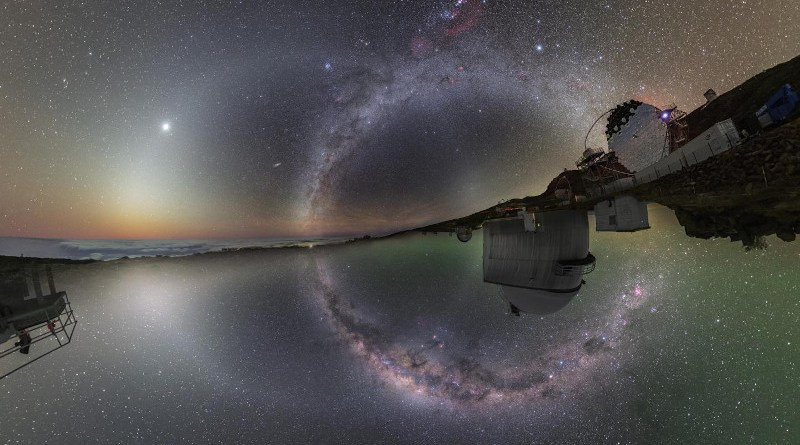 In the upper part of the image, the Observatory of the Roque de los Muchachos Observatory (Garafía, La Palma, Canary Islands) taken in February 2020. The lower part shows the sky in the southern hemisphere from the La Silla Observatory (ESO, Chile) in April 2016. In this composition the Milky Way runs almost vertically above and below the horizon. In the upper half Venus is immersed in the Zodiacal Light, which produces a complete circle through the starry sky. Andromeda and the Magellanic Clouds can also be seen. This image, produced by astrophotographers Juan Carlos Casado and Petr Horálek, was Astronomy Picture of the Day (APOD) on February 27th 2020 (apod.nasa.gov/apod/ap200227.html) CREDIT Juan Carlos Casado and Petr Horálek