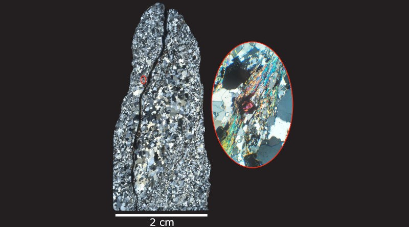 A thin, polished slice of a rock collected from the Jack Hills of Western Australia. Using a special microscope equipped with a polarizing lenses, the research team was able to examine the intricate internal structure of quartz that makes up the rock, including unique features that allowed them to identify ancient zircons (magenta mineral in the center of the red-outlined inset image in the right photo). CREDIT: Michael Ackerson, Smithsonian