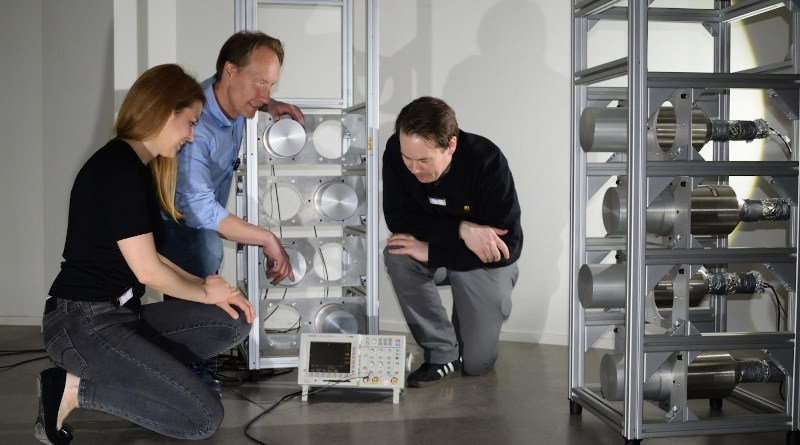 Researchers, from left, Jana Petrovic, Bo Cederwall and Alf Göök test the new imaging technology on a mock-up of radioactive waste drum scanner. CREDIT Biswarup Das