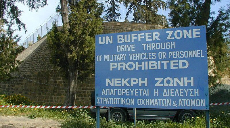 """""""UN Buffer Zone"""" warning sign on the south (Greek) side of the Ledra Crossing of the Green Line in Nicosia, Cyprus. The other side of the fence is the Turkish side. Photo Credit: Jpatokal, Wikimedia Commons"""