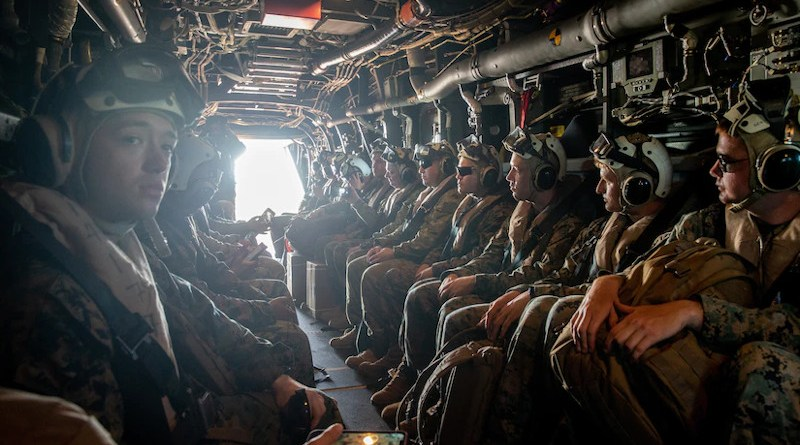 U.S. Marines and Australian service members sit aboard an Osprey en route to Darwin, Australia, after a site survey visit at Tiwi Island, Australia, in preparation for an upcoming exercise, May 3, 2021. Photo Credit: Marine Corps Master Sgt. Sarah Nadeau
