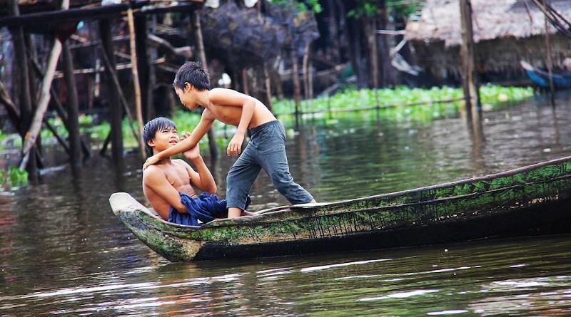 cambodia asia boys children river boat