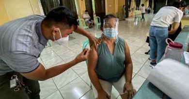 Woman gets coronavirus vaccine in Quezon City, Philippines. Photo Credit: Basilio Sepe/BenarNews
