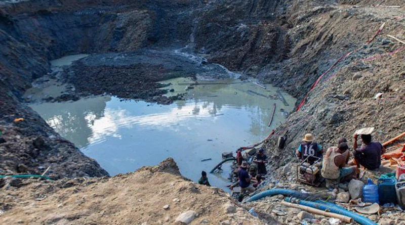 People siphon water from a pit as they prospect for gold at a mining site in Central Sulawesi, Indonesia. Photo Credit: Keisyah Aprilia/BenarNews