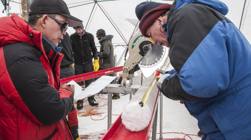 Yao Tandong, left, and Lonnie Thompson, right, process an ice core drilled from the Guliya Ice Cap in the Tibetan Plateau in 2015. The ice held viruses nearly 15,000 years old, a new study has found. CREDIT Image courtesy Lonnie Thompson, The Ohio State University