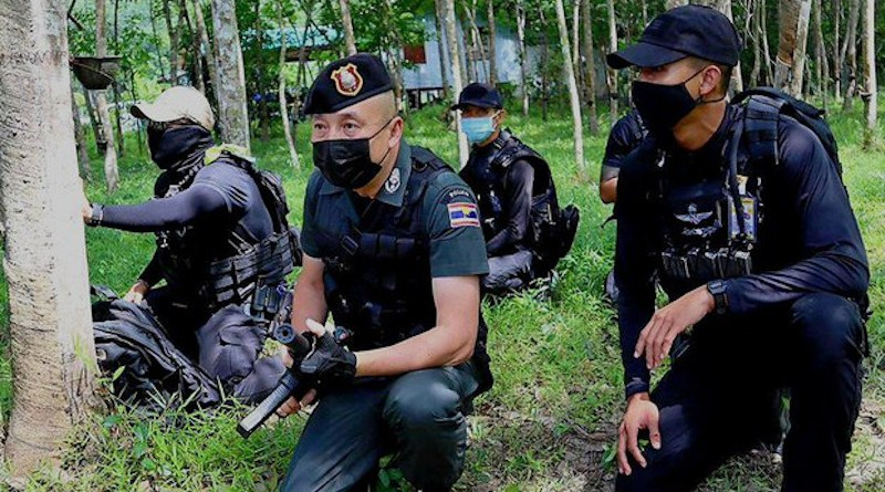 Police personnel search for suspected insurgents in Chamao Sam Ton village in Sai Buri, a district in Pattani province in Thailand, July 5, 2021. BenarNews