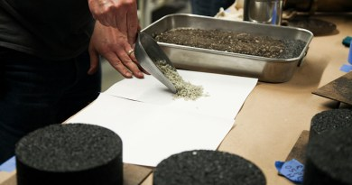 Lab staff in the Mizzou Asphalt Pavement and Innovation Lab, or MAPIL, show the plastic waste particles that are being added to the pavement mixture. The lab is located inside the MU College of Engineering. CREDIT: University of Missouri