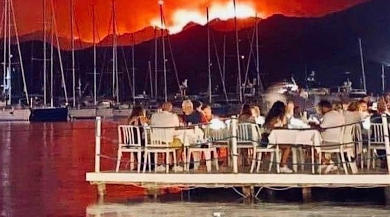 A photo from Twitter that may or may not be real, but that, I believe, expresses a profound truth about the nature of climate change, in this year of unprecedented wildfires and floods, and, in general, human beings' inability to deal with its ramifications.
