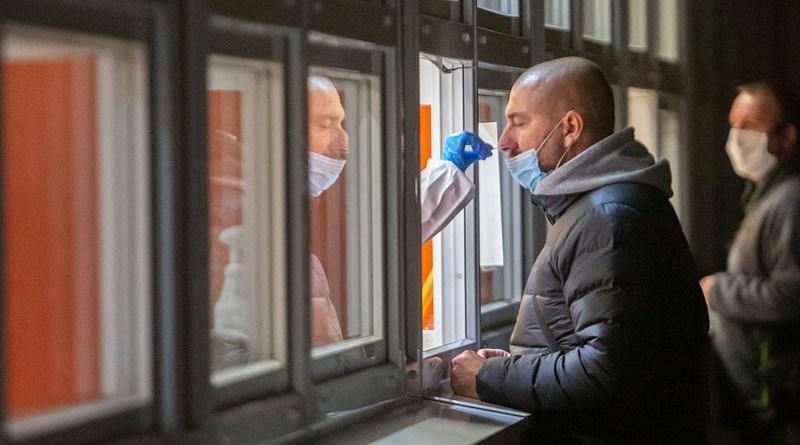 worker covid-19 coronavirus testing employees mask