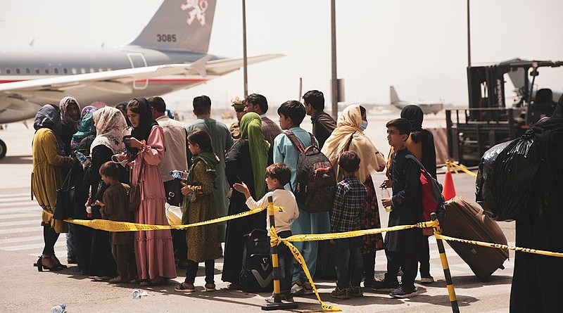 Civilians preparing to be airlifted from Kabul Airport in Afghanistan. Photo Credit: U.S. Marine Corps photo by Staff Sgt. Victor Mancilla/U.S. Central Command Public Affairs, Wikipedia Commons