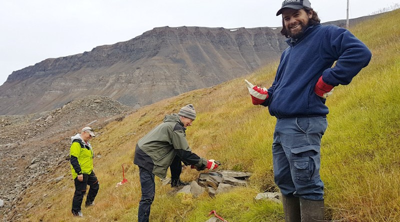 Dominique Fauteux (right) joins Norwegian scientists Stein Tore Pedersen (left) and Rolf Ims in 2019 at one of the grassy ridges on Spitzbergen Island where the voles are found. CREDIT: Eva Fuglei