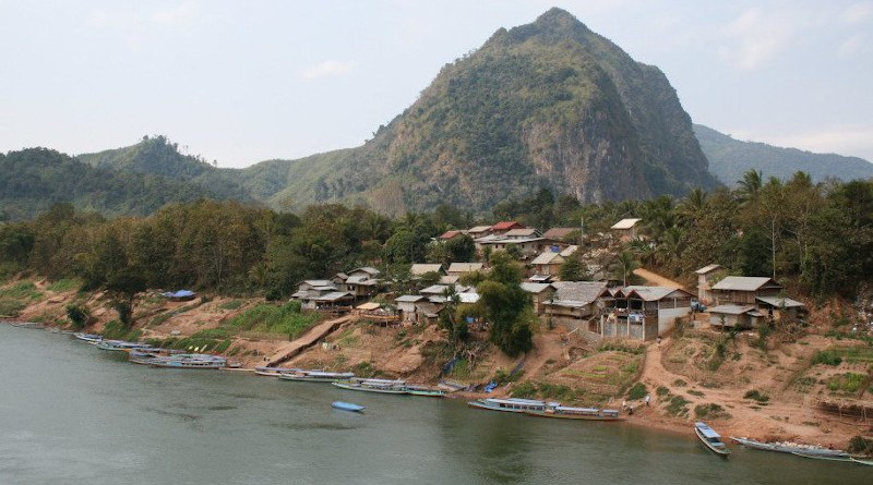 A community by the river in Laos. A new study reports that the increase in scrub and murine typhus cases in the country is linked to changing climate. Copyright: Terry Sunderland/CIFOR, (CC BY-NC-ND 2.0). This image has been cropped.