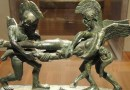 Sleep and Death Carrying off the Slain Sarpedon (cista handle), 400-380 BC, Etruscan, bronze - Cleveland Museum of Art CREDIT: Daderot, CC0, via Wikimedia Commons
