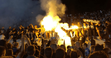 A row of Partizan supporters, including members of Belivuk's group, celebrate their team's victory on the south terrace of Partizan stadium in May 2017. Photo: BIRN
