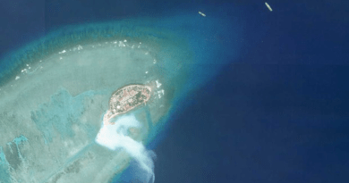 Satellite imagery shows work taking place on the southern tip Pearson Reef in the South China Sea on Friday. (Planet Labs)