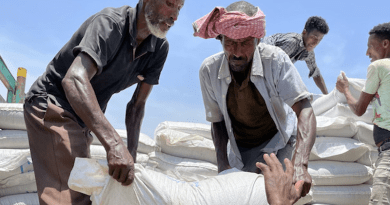 Photo: Food being unloaded from a truck at a WFP distribution site in Zelazle in the north of Tigray. © WFP/Claire Nevill