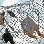 "Source: Prodein - A ""Concertina"" fence after a jump in Melilla in 2005."