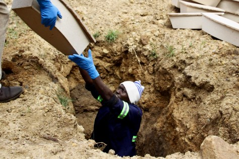 """While adult """"paupers"""" are buried three to a grave, up to the 30 of the small chipboard coffins containing the remains are babies are buried together at Doornkop Cemetery in Soweto."""