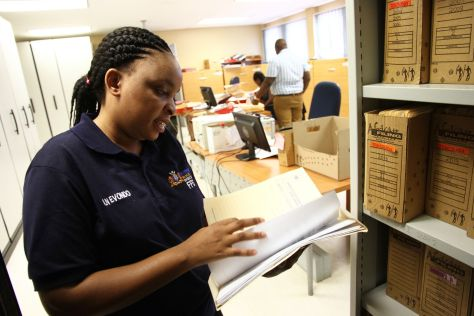 Forensic officer Azwidowi Nevondo checks toxicology reports stored at the Hillbrow Medico-Legal lab in Johannesburg. One of the country's busiest mortuaries, it processed over 3100 bodies in 2016.