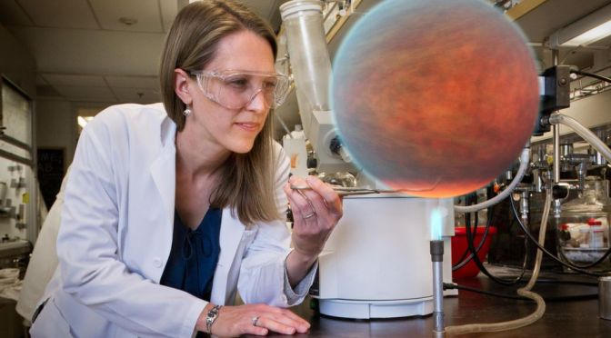 Work-life balance: A female scientist looking at a planet created in a laboratory (artistically altered)